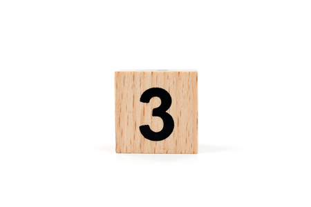 Wooden block Number three on white background