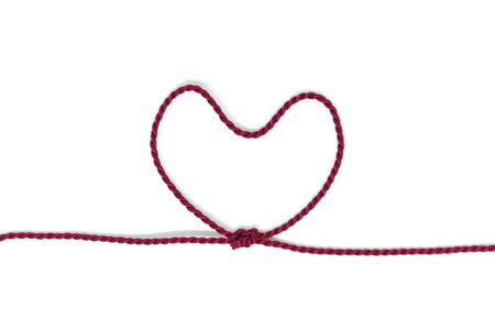 Heart Shaped Knot on a rope on white background