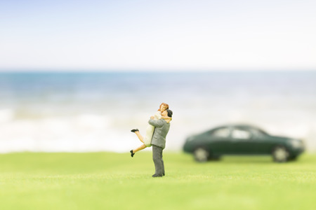 Miniature couple on the beach background Stock Photo