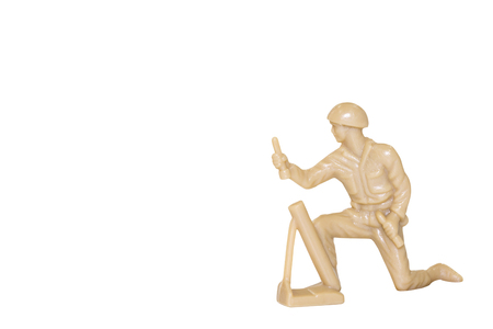 plastic soldier: Miniature toy soldier on white background with clipping path