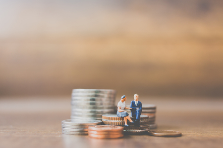 Miniature people businessman  on coins and space for text