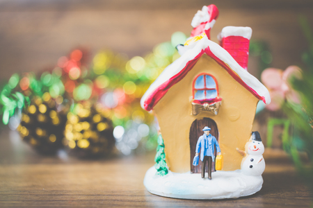 Miniature people in the village celebrate Christmas Day , Holiday concept. Joy, holiday, winter, happy, family, friends Stock Photo