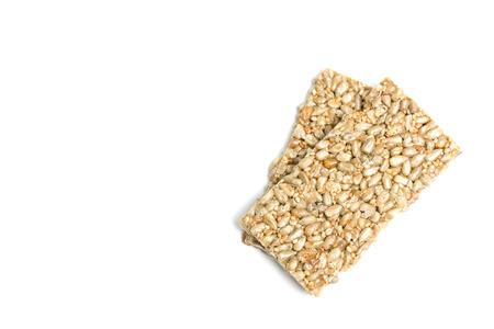 Sunflower kernels and Sesame bar isolate on white background Reklamní fotografie