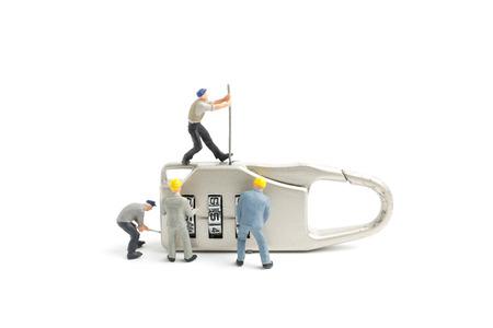 Miniature people worker  : Teamwork helps to unlock password on the keys. Team work concept. Standard-Bild