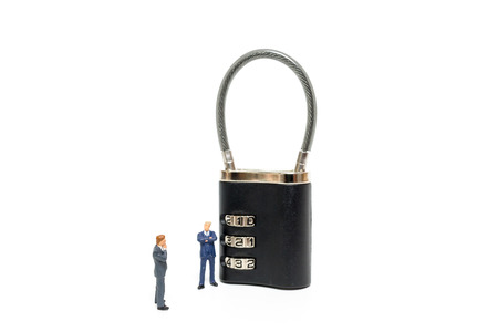 Miniature people : businessman helps to unlock password on the keys : Business concept the solution to the problem.