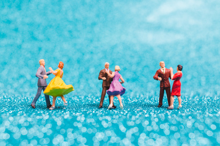 Miniature people , Couple dancing on blue glitter background , Valentine's day concept