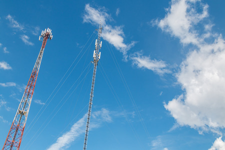 Cellular phone antennas with sky blue background. Stock Photo
