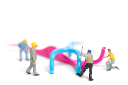 Miniature people : The team work on Dental floss isolate on white background , Dental clinic concept