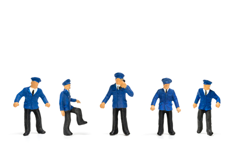 Miniature people : Policeman standing isolate on white background Stock Photo