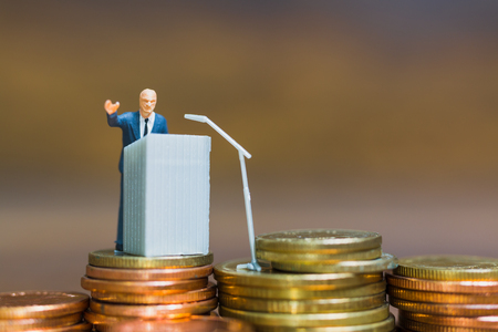 Miniature people : Businessman speaking on the podium , Business and finance investment concept Stock Photo