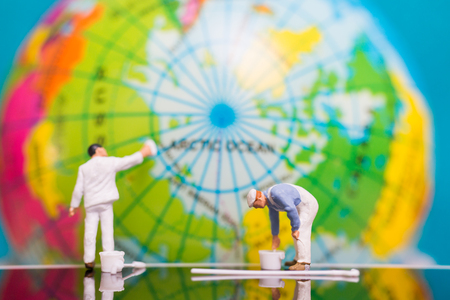 Miniature people : Painters painting on The globe  background , Earth day concept