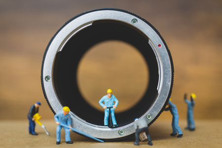 Miniature people : Worker team checking The pipe , Plumbing repair service concept Banco de Imagens