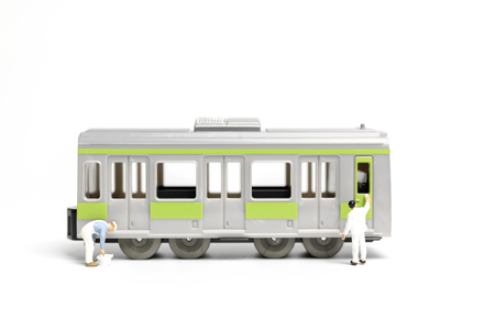 Miniature people : Painters painting a Train on white background , Repairing concept Stock Photo