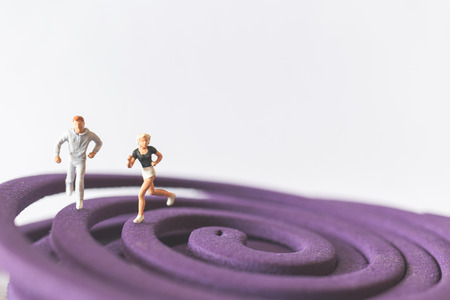 Miniature people : Couple Running on the purple field , Valentines Day concept Stock Photo