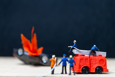 Miniature people : Firefighters at a car accident  , Cars on fire blow up