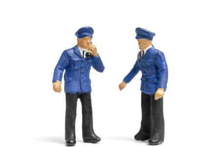 Miniature people : Policeman standing on white background