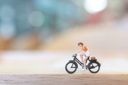 Miniature people  cycling on wooden bridge , Health care concepts Stock Photo