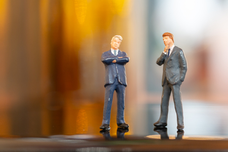 Miniature people : Businessman  standing and thinking with colorfull background Stock Photo