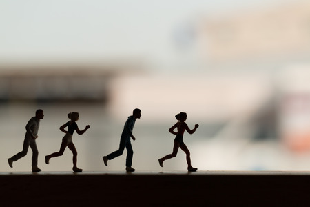 Miniature people is Running , Silhouette of a runner , Health And lifestyle concepts. Stock Photo