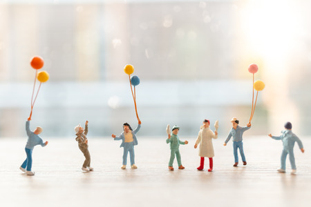 Miniature people : Happy family walking with balloons ,  Happy family Concept Banco de Imagens - 120162500