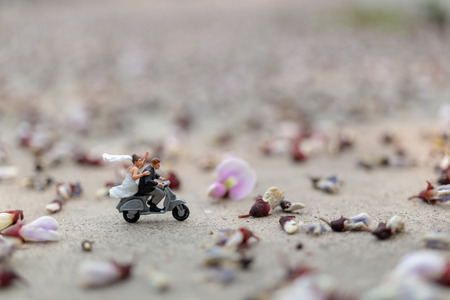 Miniature people : Couple riding the motorcycle in the garden  , Valentines Day concept Reklamní fotografie