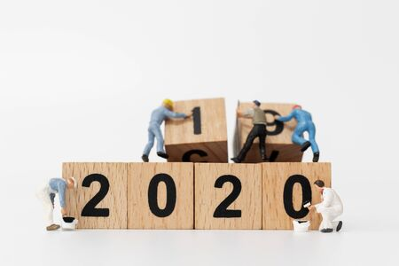 Miniature people : Worker team create wooden block number 2020  , Happy new year concept Stock Photo