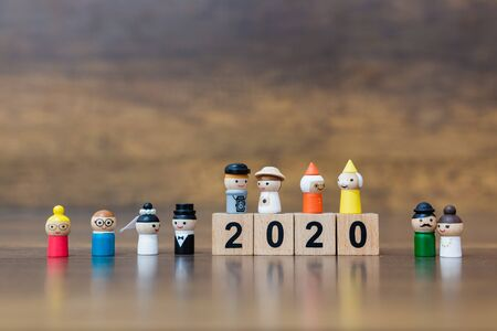 Miniature toy : Wooden doll with  wooden block number 2020