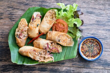 Top view Fried spring rolls on wooden background. Banco de Imagens