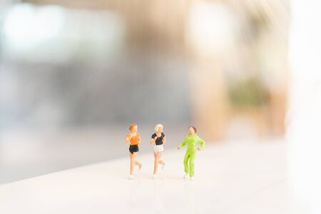 Miniature people running , Healthy and sport concepts. Reklamní fotografie