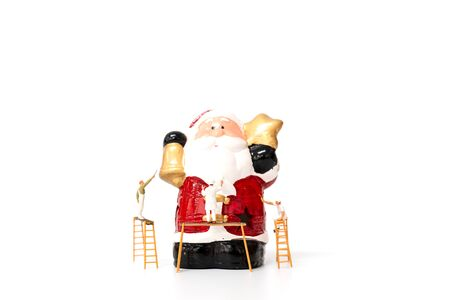 Miniature worker team painting Christmas prop on white background , Merry Christmas and Happy new year concept