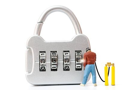 Miniature people working on combination lock number 2020 , Happy new year concept Reklamní fotografie