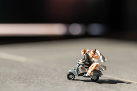 Miniature people : Couple in love riding a motorbike, Adventure and vacations concept.