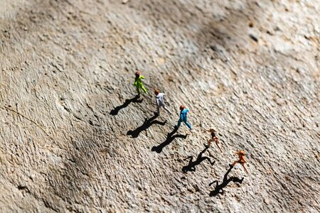 Miniature people : Group of people are running  on concrete floor,  Healthy and lifestyle concept Reklamní fotografie