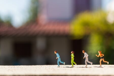 Miniature people : Group of people are running  on concrete road,  Healthy and lifestyle concept Reklamní fotografie
