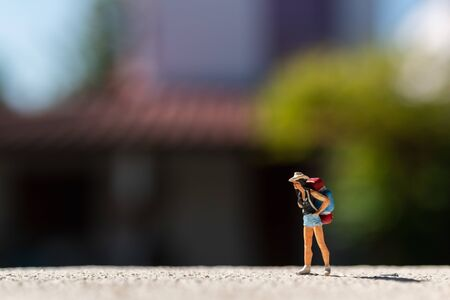 Miniature people :  Traveler with backpack standing on The road. Travel Concept Reklamní fotografie