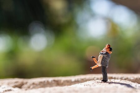 Miniature people :  Couple standing in the park, Happy valentines day concept