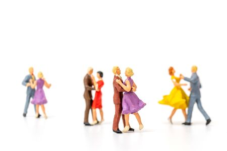 Miniature people , Couple dancing on white background , Valentine's day concept