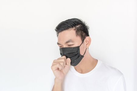 Asian Man wearing mask protect fine dust in air pollution environment , Protection equipment for air pollution concept