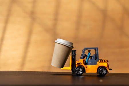 Miniature People and Coffee to-go Cup , Coffee delivery concept