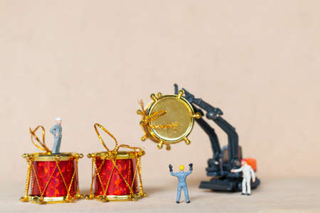 Miniature people,  Worker team working with a Christmas decoration , Christmas and Happy New Year concept.