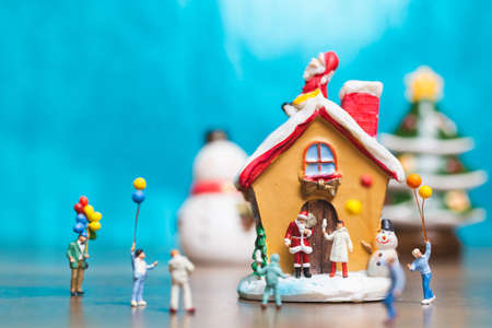 Miniature people, Happy family celebrating A Christmas  , Christmas and Happy New Year concept. Stock Photo