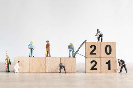 Miniature worker team create number 2021 , Happy new year concept Stock Photo