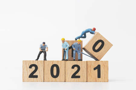 Miniature people : Worker team create wooden block number 2021  , Happy new year concept Stock Photo