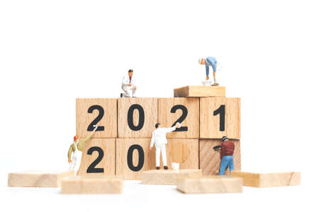 Miniature people : Worker team create wooden block number 2021 , Happy new year concept