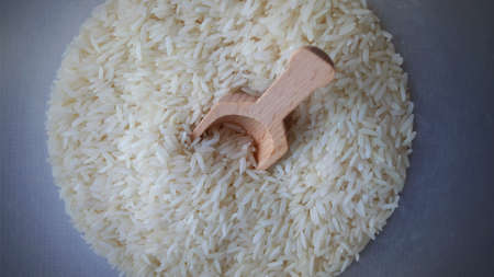 Top View Wooden Spoon With Rice on Wooden Background, Jasmine Rice on Wooden, Empty Space For Text