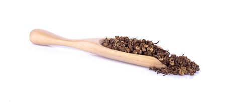 Dry Zanthozylum limonella Alston in wooden spoon on white background