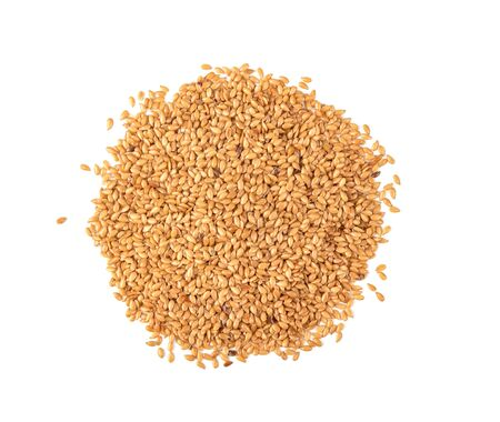 Golden flax seeds on a white background. Organic food.