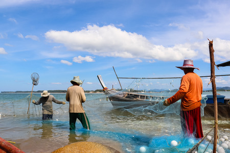 The life of a fisherman who was out fishing Thailand using small boats to fishermen in the morning every day to eat and sell. Stock Photo