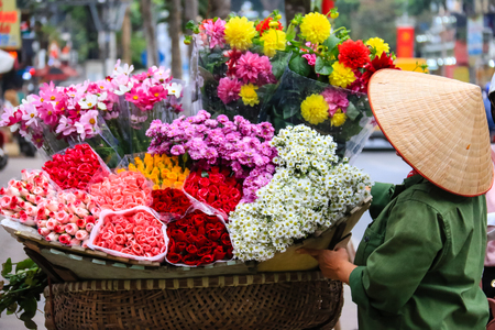 women selling flowers on the streets by biclcle