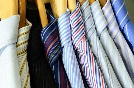 Shirts on wooden hangers photo